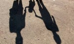 shadow of young family holding hands
